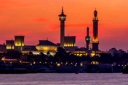 building of a mosque at sunset in Dubai Creek