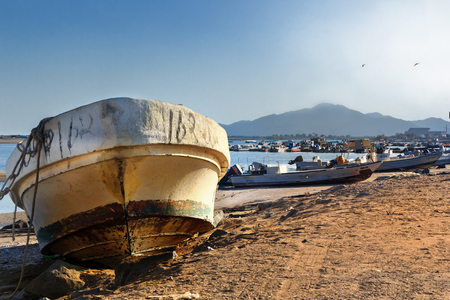 Fujairah, UAE - January 4, 2017. old fishing boat on the beach in the port of Kalba. Settlement Kalb is part of the district of Fujairah and is almost on the border with Oman.