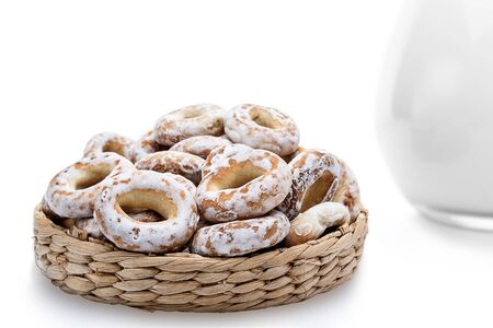 breadbasket: Whole bagels in a wicker basket. Sweet bread. isolated