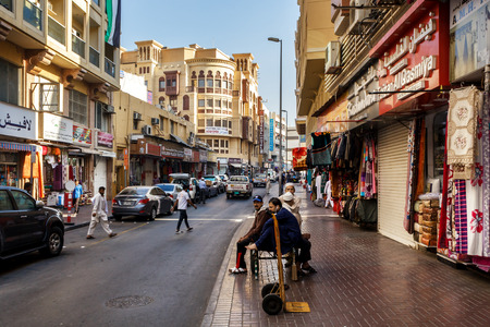 sidewalk sale: Dubai, UAE - January 9, 2017. Street loaders are waiting for work on the streets of old Dubai. Street loaders are waiting for work on the streets of old Dubai. Deyra- Dubais old district, where the old port, the fish market, gold market, a variety of sho Editorial