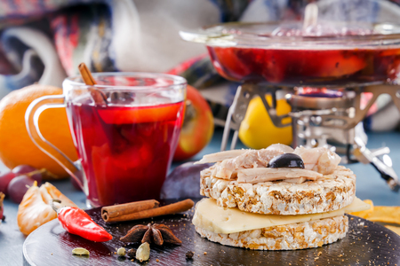 Mulled wine with Puffed wheat cake, chicken meat, fruits and spices. Fruit tea. Punch, grog. Hot winter wine.