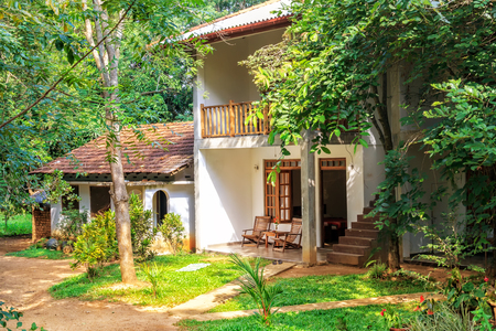 Sigiriya, Sri Lanka - January 4, 2018. Traditional colonial style house stands in a rainforest on a sunny day