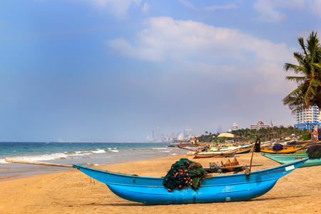 Colombo, Sri Lanka - January 11, 2018. traditional fishing boat stands on the beach before going to sea