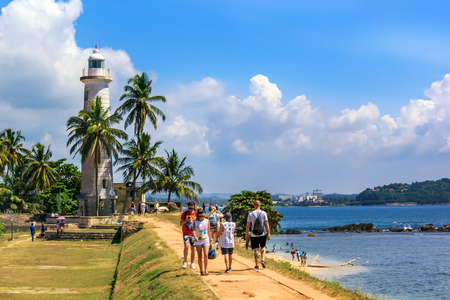 Galle, Sri Lanka - January 13, 2018. tourists walk along the remnants of the fortress wall of the fort on a sunny day
