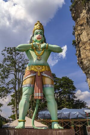 Kuala Lumpur, Malaysia - December 30, 2018. Large statue of the Buddhist Deity of Hanuman Hindhu, 15 meters high, is located near the entrance to the Ramayana cave