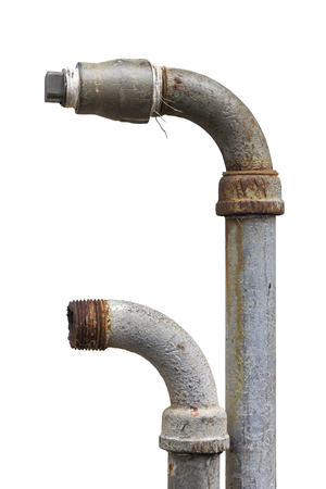 Old rusty pipes with taps and fittings isolated on white background. Close-up