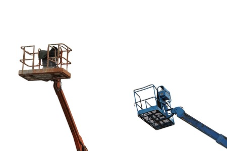 Two working hydraulic aerial platforms for high-altitude work in red and blue isolated on white background