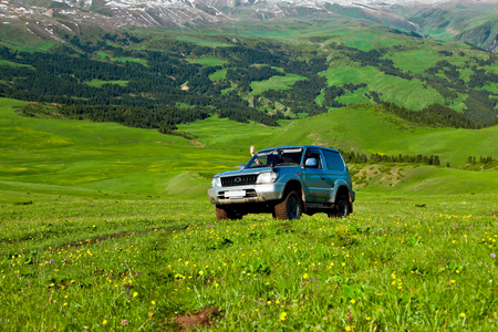 On hiking trails to high mountains and down to green meadows Stock Photo