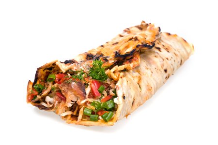 Rolled meat with vegetables wrapped bread cake, tortilla or flat pancake of cornmeal or flour