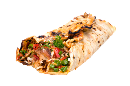 Meat with vegetables wrapped bread cake, tortilla or flat pancake of cornmeal or flour