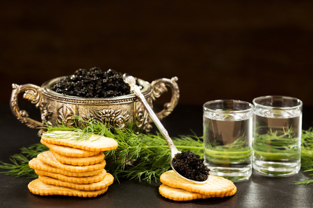 Two glass of black caviar snacks
