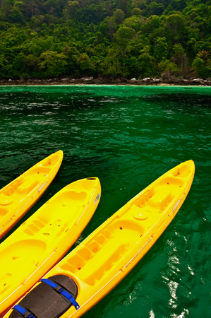Three yellow kayak in tropics. 写真素材