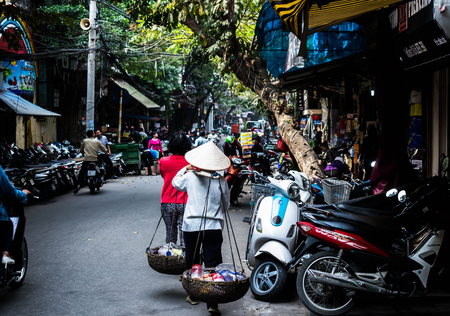 Phuket city street with people and motorcycles 報道画像