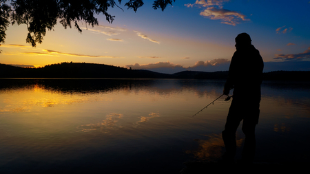 Spinning fishing (lure fishing) trout in lakes of the world. Brook trout (steelhead rainbow trout, char, bull-trout, cutthroat, lax, salmon and pink salmon caught on rotating spinner, close up photography