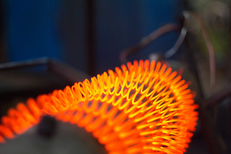 The nichromic filament spiral on a heater. Glower close up