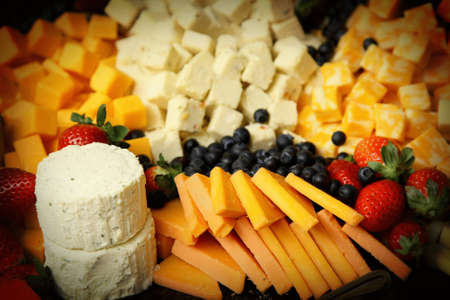 A close up of cheeseboard with different kinds of cheese for an appetizer
