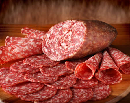 Sliced salami o table close-up view