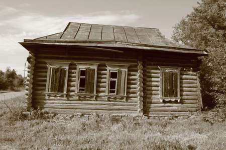 log house: Old abandoned one-storey wooden log house in russian village Stock Photo