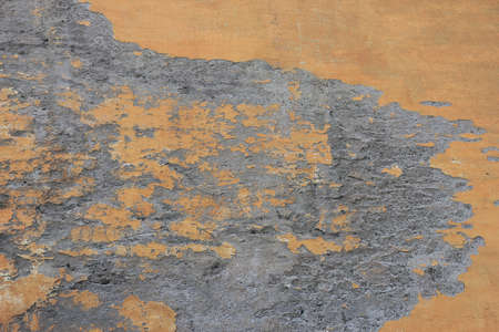crumbled: dilapidated crumbled medieval plastered orange wall in small roman street