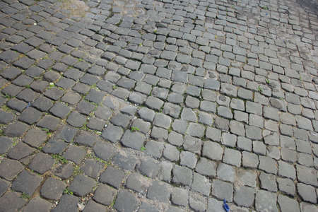 dilapidated: Ancient roman dilapidated small square stone paving in Rome, Italy Stock Photo