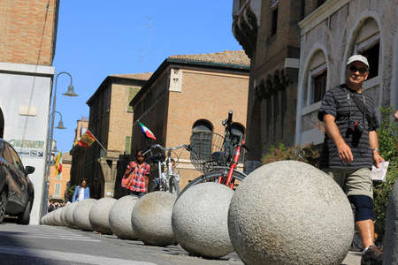 trafic stop: Interesting big grey concrete parking balls in the central square of Ravenna, Italy