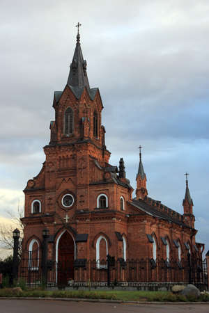 gothic style: Beautiful red brick ancient catholic cathedral in gothic style in the centre of town Vladimir, Russia Stock Photo