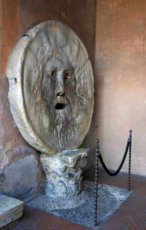 manlike: ancient roman marble man-like face the Mouth of Truth (Bocca della Verita), Rome, Italy Stock Photo