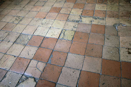 boxy: old cracked ceramic floor tiles terracotta color