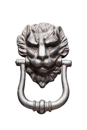 forefront: doorknocker, door, knocker, lion, head, iron, entrance, portal, frame, street, town, outside, new, old, medieval, ancient, form, lev, handle, black, dark, bright, rusty, sharp, focus, closeup, forefront, one, light, white, good, beautiful, look, like, fac Stock Photo