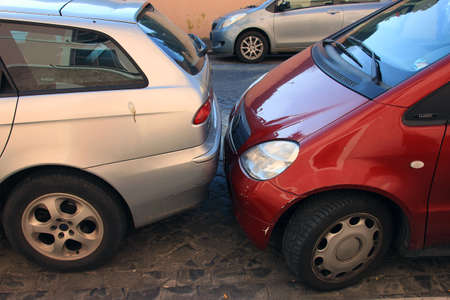 tight: example of tight close car parking in european cities, Rome, Italy