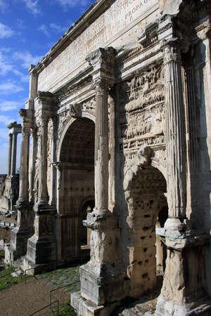 severus: ancient roman marble triumphal arch of Septimius Severus (Arco di Settimio Severo) in  Roman Forum, Rome, Italy Editorial
