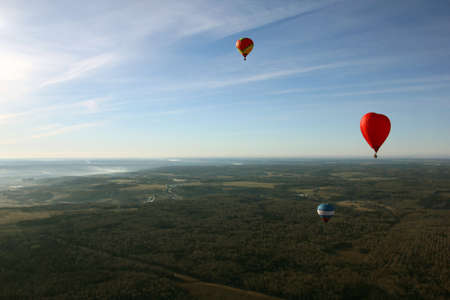birds eye view: views of field, balloons, countryside, blue sky and horizon from the birds eye view from a hot air balloon