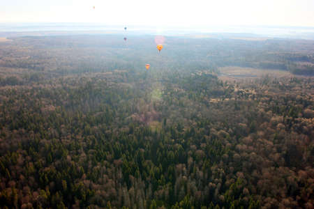 aeronautics: views of field, balloons, countryside and horizon from the birds eye view from a hot air balloon