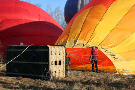 gas burner: Process of inflating the orange balloon with gas burner with hot air, Dmitrov, Russia Editorial