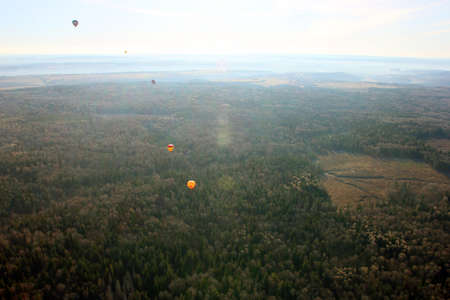 birds eye view: views of field, balloons, countryside and horizon from the birds eye view from a hot air balloon