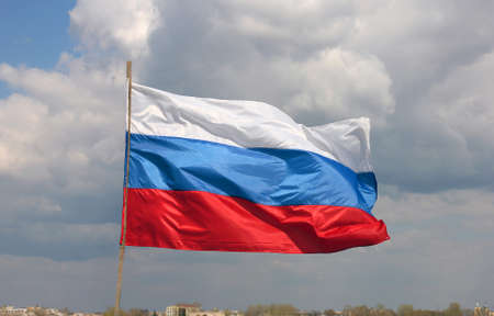 russian federation: colorful bright beautiful state flag of Russia (Russian Federation) waving on the wind on blue sky background with white clouds Stock Photo