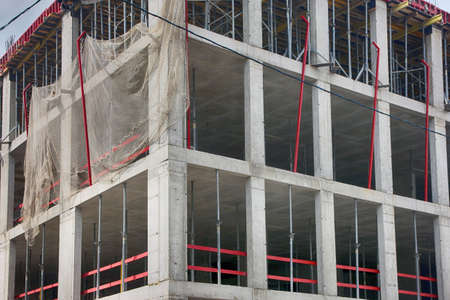 monolithic: corner of concrete building under construction with monolithic reinforced concrete frame in Moscow, Russia