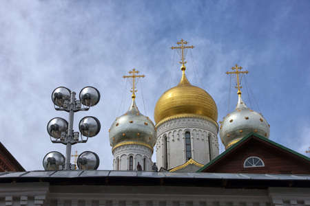 dome type: golden dome of russian orthodox cathedral and spotlight for lighting of buildings on roof Stock Photo