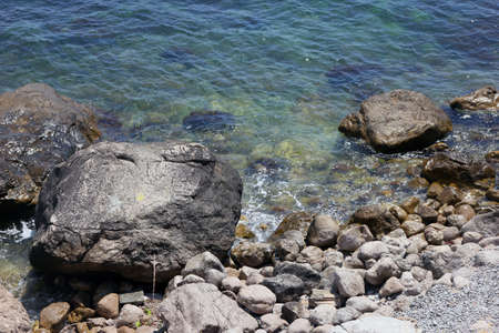 limpid: beautiful picturesque wild Black sea coast with boulders and rocks in sea water Stock Photo