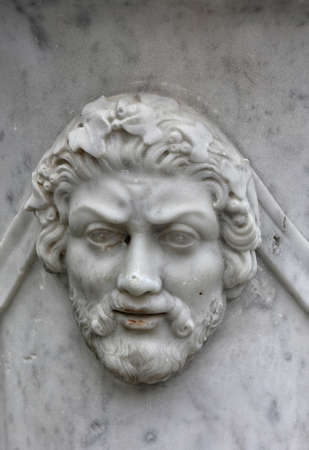 fas: marble bas-relief in the form of ancient man face with beard on wall of vase