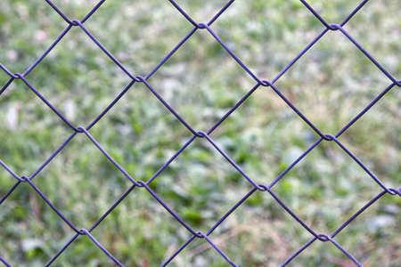 netting: mesh netting galvanized on the background of grass Stock Photo