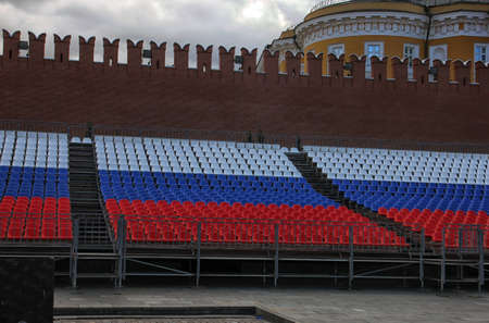 Stands in colors of russian flag on red square in Moscow near Kremlin wall Stock Photo