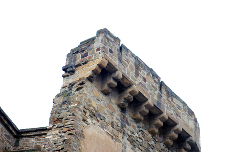 fragment of top of wall of beautiful old ancient mountain castle - Genoese fortress. The medieval citadel Foto de archivo