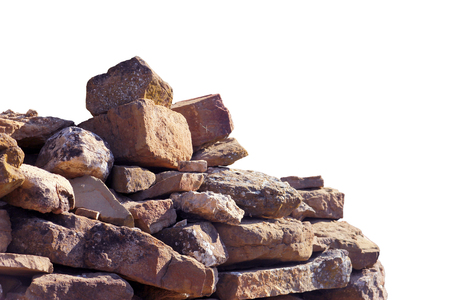 old ancient ruined pile of bricks and stone blocks foreground closeup isolated on white background