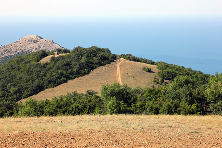 excellent panoramic sea and mountain view and mountain landscape view from rocky sandy flat top in Crimea bird eye view