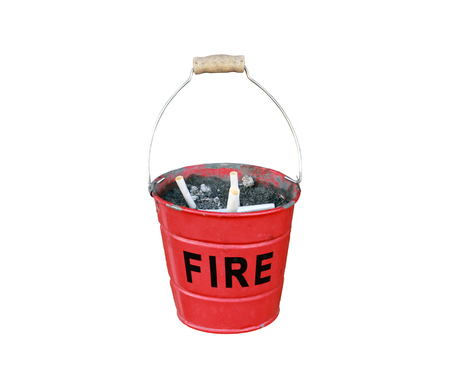 ashtray in the form of a small red fire bucket with the inscription FIRE isolated on white background close up Stock Photo