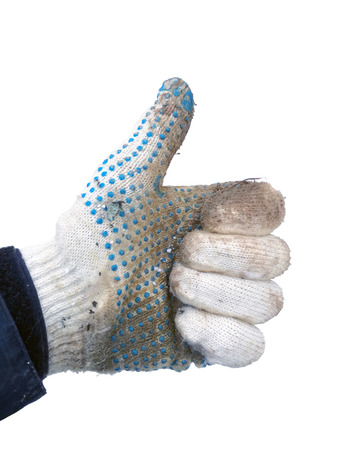 photo of hand in a dirty working white knitted cotton glove shows sign thumbs up isolated on white background in winter closeup