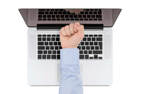Top view of modern retina laptop with a man s fist pointing at the screen on white background  You can put any image on the screen, while retaining reflection of keyboard  photo