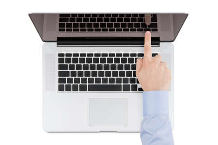Top view of modern retina laptop with a man s hand pointing at the screen on white background  You can put any image on the screen, while retaining reflection of keyboard  photo