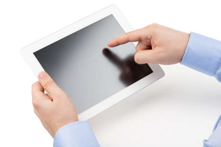 Man s hands are holding a tablet computer and points a finger at the screen on a white background